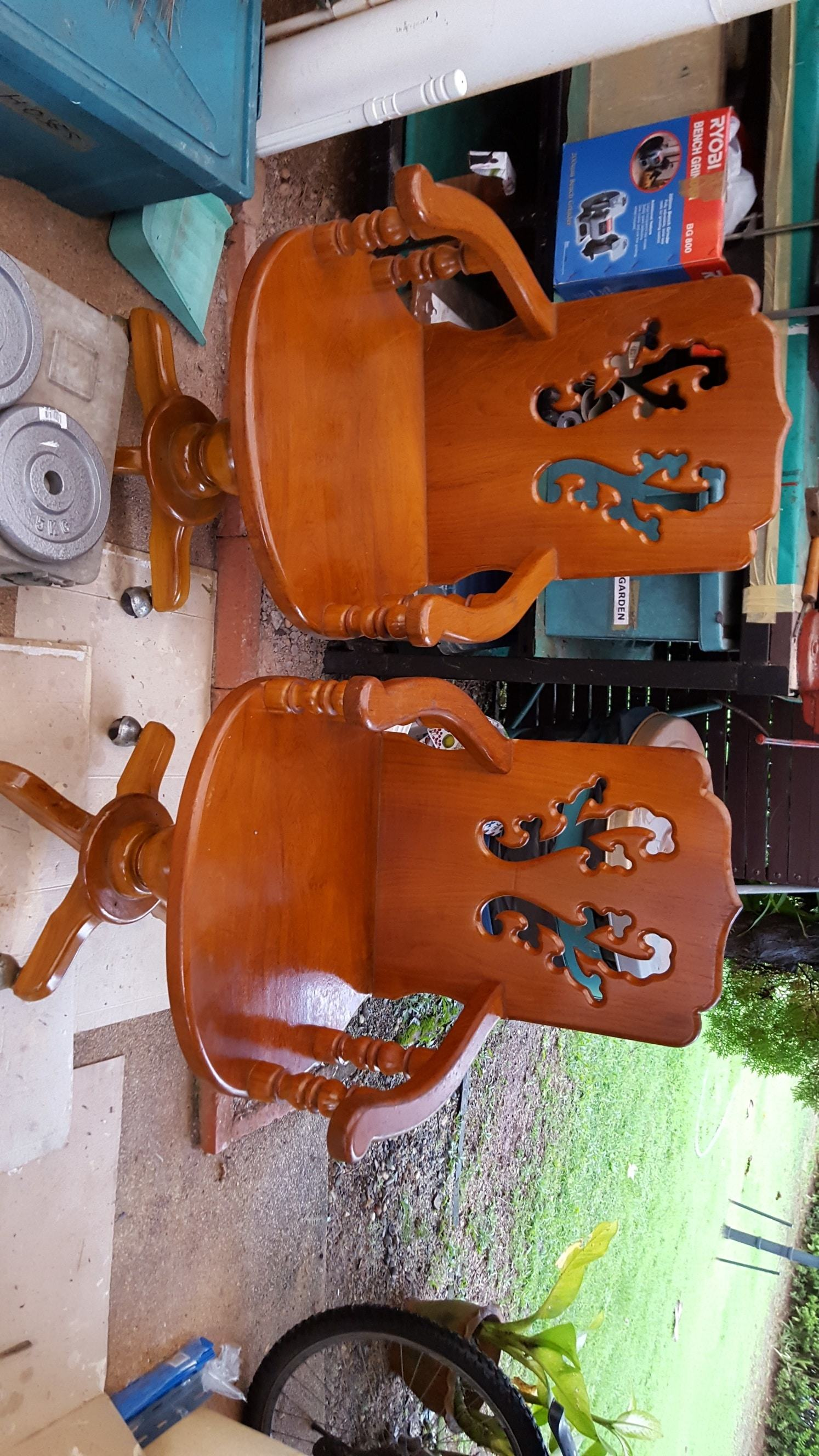 2 Teak wood chairs