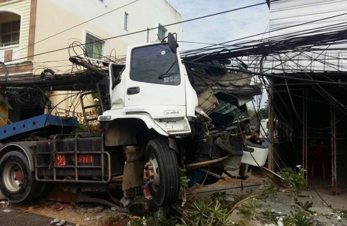 Two injured as truck crashes into utility pole in Phuket | The Thaiger