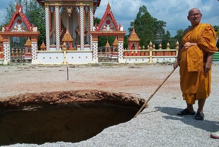 Krabi locals link temple sinkhole to Naga appearance | The Thaiger