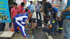 Don't walk and talk. Woman gets stuck in drain. | News by Thaiger