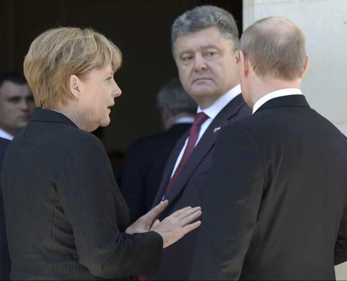 Ukraine crisis; Putin, Poroshenko break ice at D-Day event   Thaiger