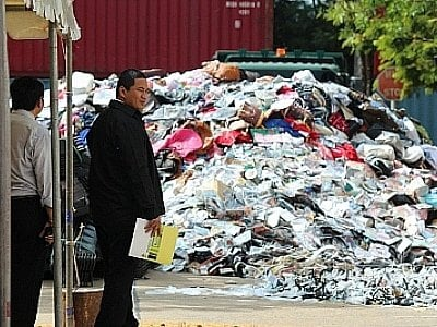 Officials 'slash and burn' 25 tons of pirate goods in Phuket | The Thaiger