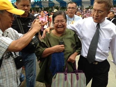 Woman faces lese majeste charge pending mental examination | The Thaiger