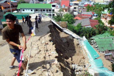 Lucky escape for mother, baby as Phuket hillside resort wall collapses | The Thaiger