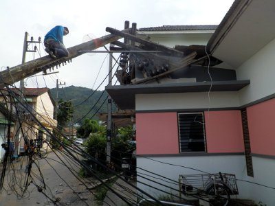 Burst water main topples power pole in Phuket | The Thaiger