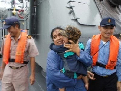 Navy rescues stranded tourists as Phuket storms continue | The Thaiger