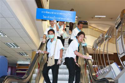 Phuket Airport staff sing for victory against swine flu | The Thaiger