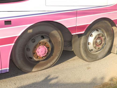Runaway wheel from Phuket tour bus narrowly misses policeman | The Thaiger