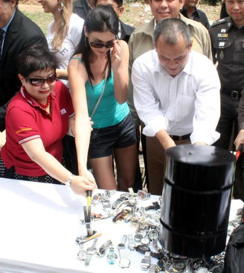 Miss Universe smashes pirated products in Phuket | The Thaiger