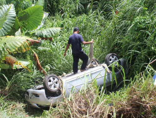 Phuket driver escapes injury as car flips, plunges into canal | The Thaiger