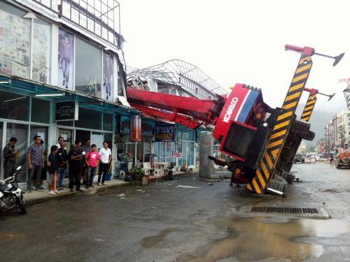 Phuket crane loses balance, operator flees scene of destruction | The Thaiger