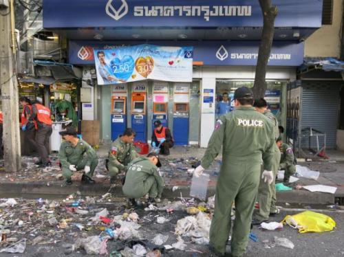 Phuket Gazette Thailand News: Gangs suspected in Bangkok blast; Red shirts, white masks; Tusks trimmed after fatal elephant attack; All silent on Bangkok F1 noise | The Thaiger