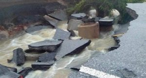 Songkhla floods destroy road - car falls into hole | News by Thaiger