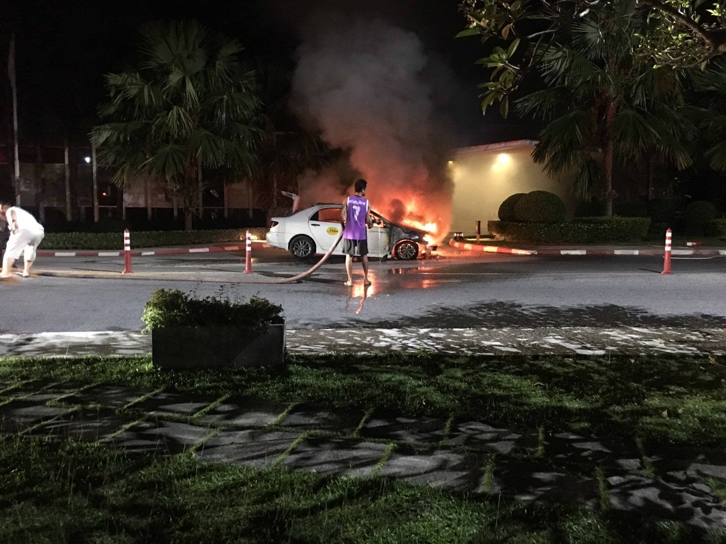 Taxi catches fire outside Cassia Laguna Hotel – No injuries | The Thaiger
