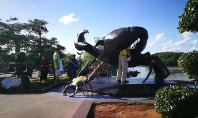 Warning stickers placed on Krabi mud crab sculpture | The Thaiger