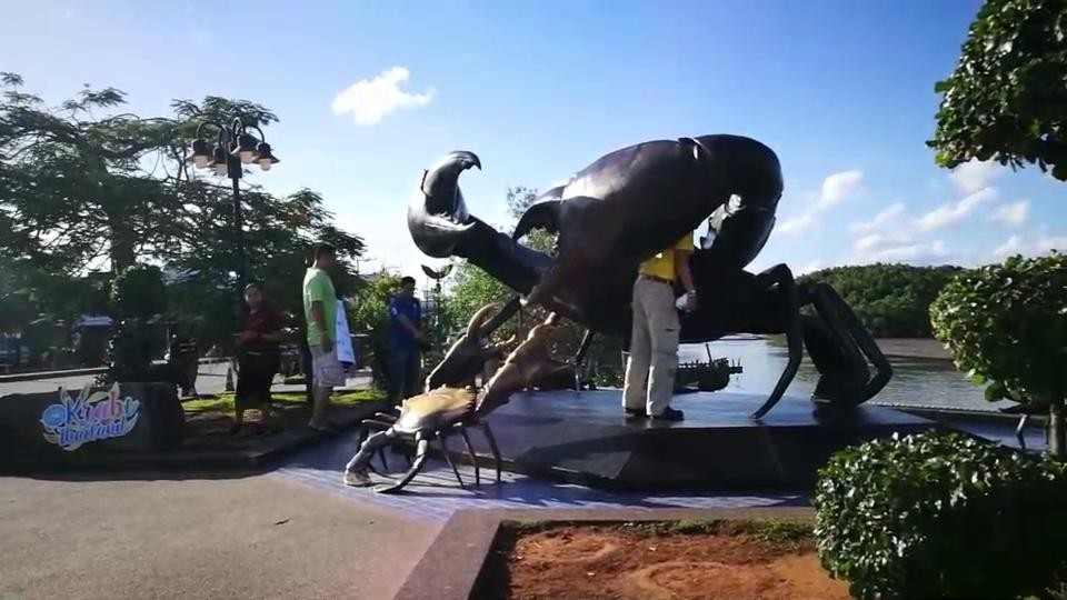 Warning stickers placed on Krabi mud crab sculpture   The Thaiger