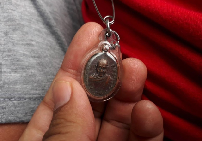 """Miracle as amulet """"saves"""" father and son in Chiang Mai 
