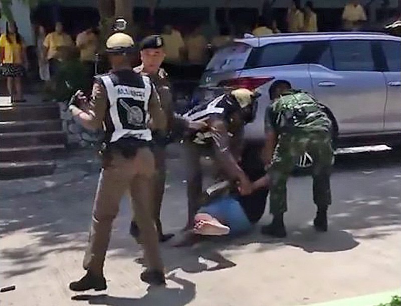 Police drag man out of Pattaya school after ex-wife clams he was carrying a gun | The Thaiger