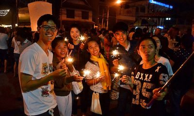 Teenagers lighting up more than their krathongs | The Thaiger