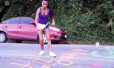 Foreigner woman caught on video spray painting road in Rawai | The Thaiger