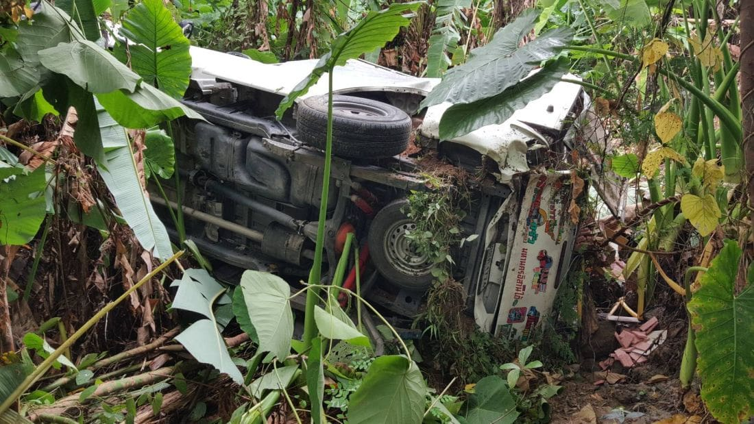 Overloaded pickup truck rolls off road into Rawai jungle | The Thaiger