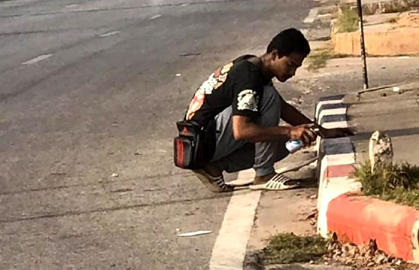 Pro-active street vendor uses spray paint to create parking spot | The Thaiger