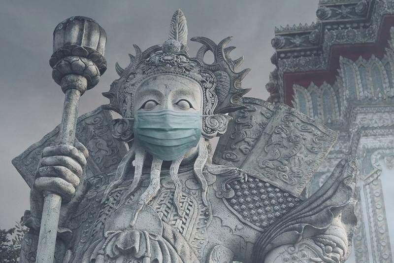 Facemasks on sacred statues gets BKK photographer into hot water | News by The Thaiger