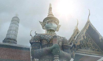 Facemasks on sacred statues gets BKK photographer into hot water   The Thaiger