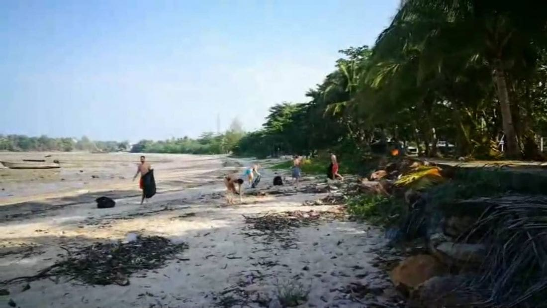 Five foreigners spend their holidays cleaning up rubbish along Krabi Beach | News by The Thaiger
