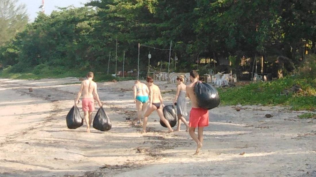 Five foreigners spend their holidays cleaning up rubbish along Krabi Beach | The Thaiger