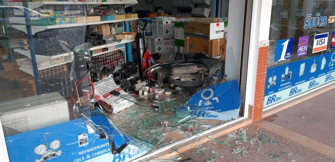 Motorbike driver smashes through glass window after accelerator malfunctions