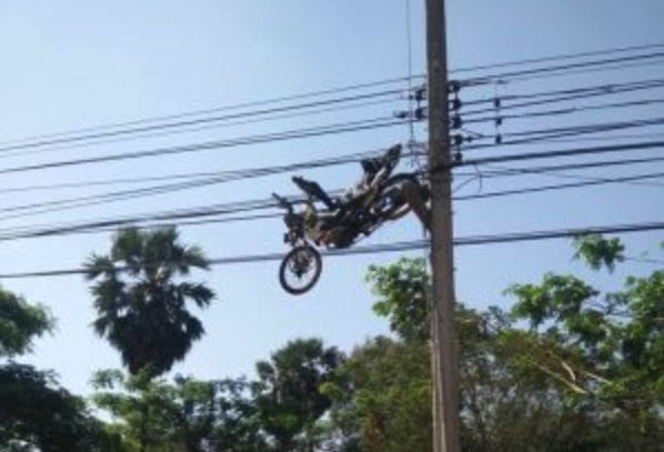 Flying motorbike ends up stuck in power lines in Surin | The Thaiger