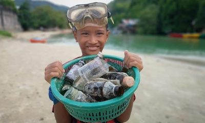 Patong's trash hero rewarded for collecting garbage in filthy canal | The Thaiger