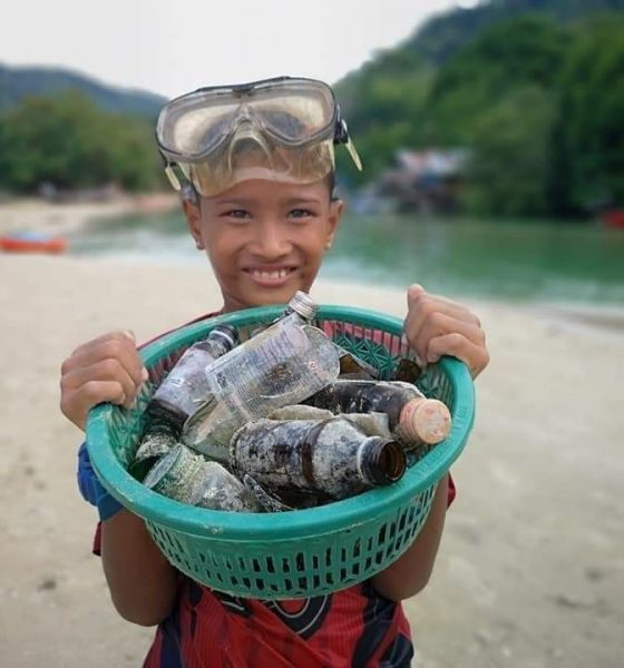 Patong's trash hero rewarded for collecting garbage in filthy canal   The Thaiger