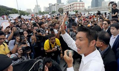 Thanathorn urged to 'fight on' as he surrenders to Bangkok police | The Thaiger