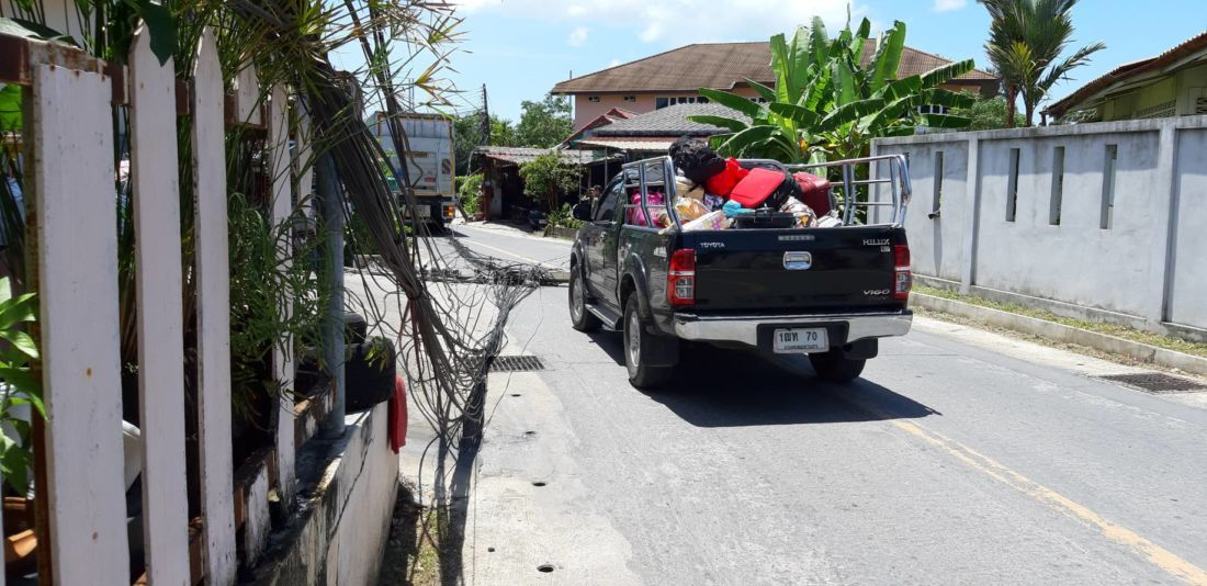 Truck brings down six power poles in Chalong, one injured | News by The Thaiger