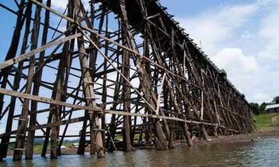 Thailand's longest wooden bridge under threat of collapse after rains soak west | The Thaiger
