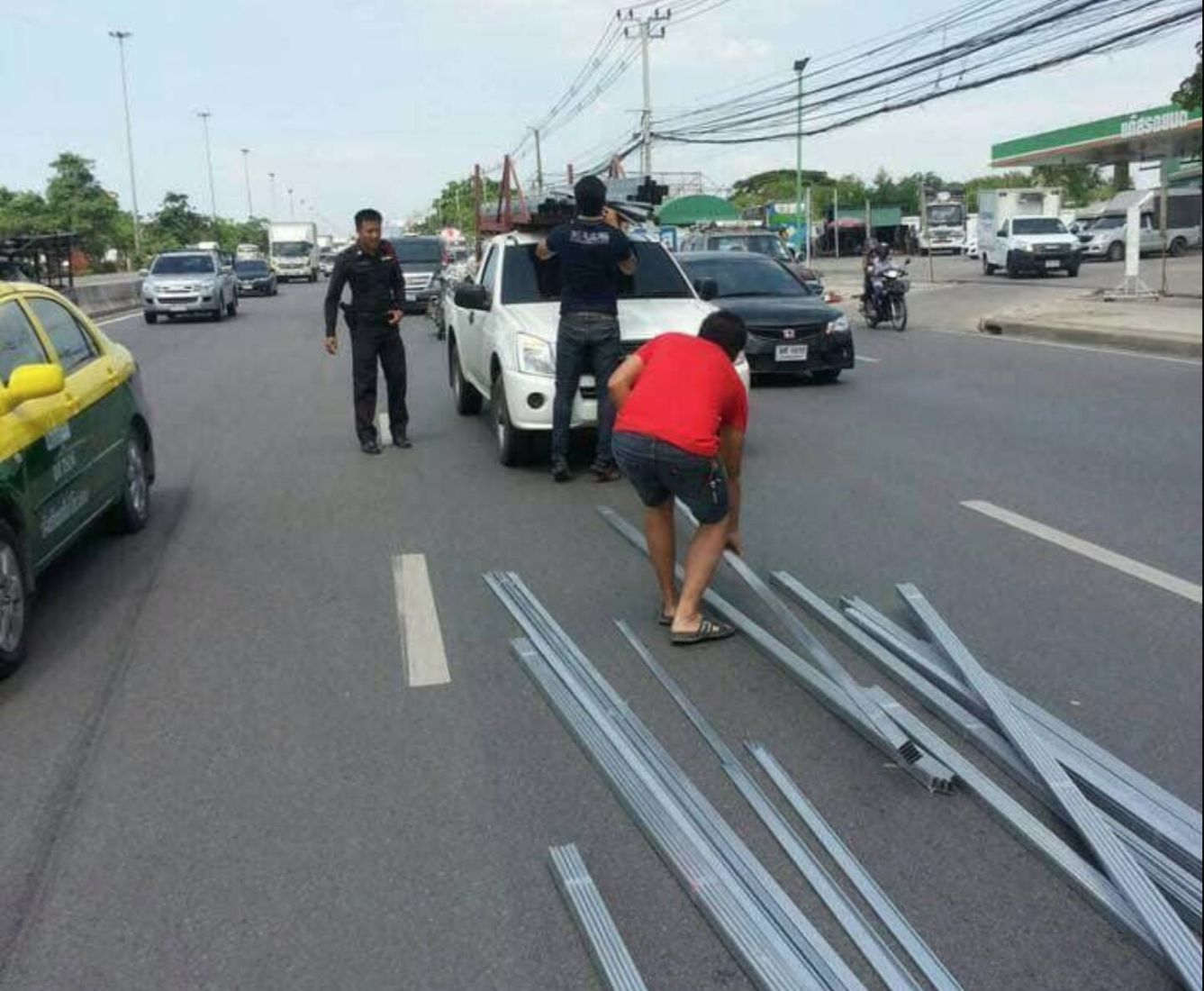 Loose steel pipe spears car through the back window | News by Thaiger