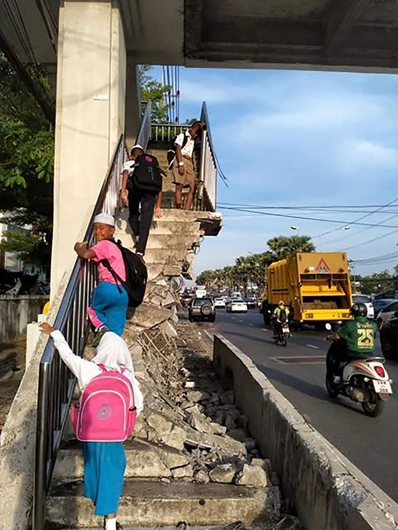 Students clamber up destroyed stairway to get to school in Phuket