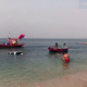 Strong waves drags pickup and jet ski into the sea in Chonburi | Thaiger
