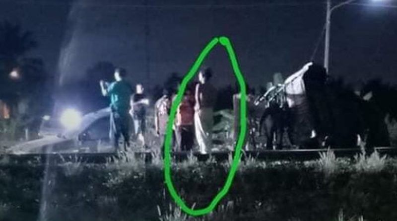 A watchful ghost is photographed at a train crash scene west of Bangkok