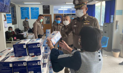Policeman nabbed with 7,500 masks and for breaking national curfew in the north-east   Thaiger