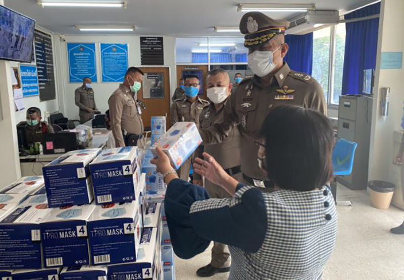 Policeman nabbed with 7,500 masks and for breaking national curfew in the north-east | Thaiger