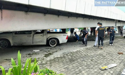 Pattaya driver blames wet weather after losing control and jamming truck under overpass – VIDEO | Thaiger
