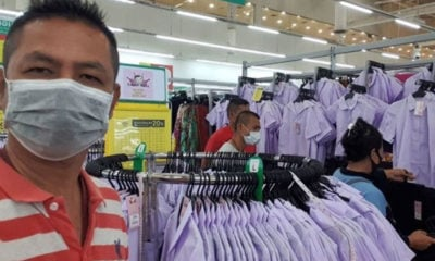 Customers help woman detained for shoplifting school uniforms   Thaiger
