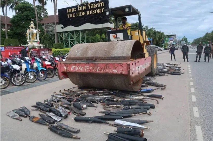 Chon Buri police hire a steam roller to destroy over 700 illegal motorbike exhausts | Thaiger