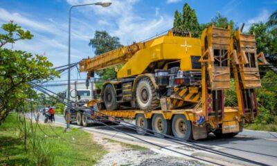 Chon Buri crane truck pulls down over a dozen power poles | Thaiger