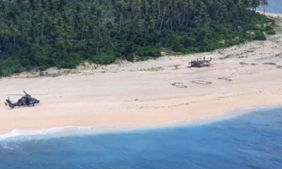 3 men saved after rescuers spotted a huge SOS in the sand on remote Pacific island | The Thaiger