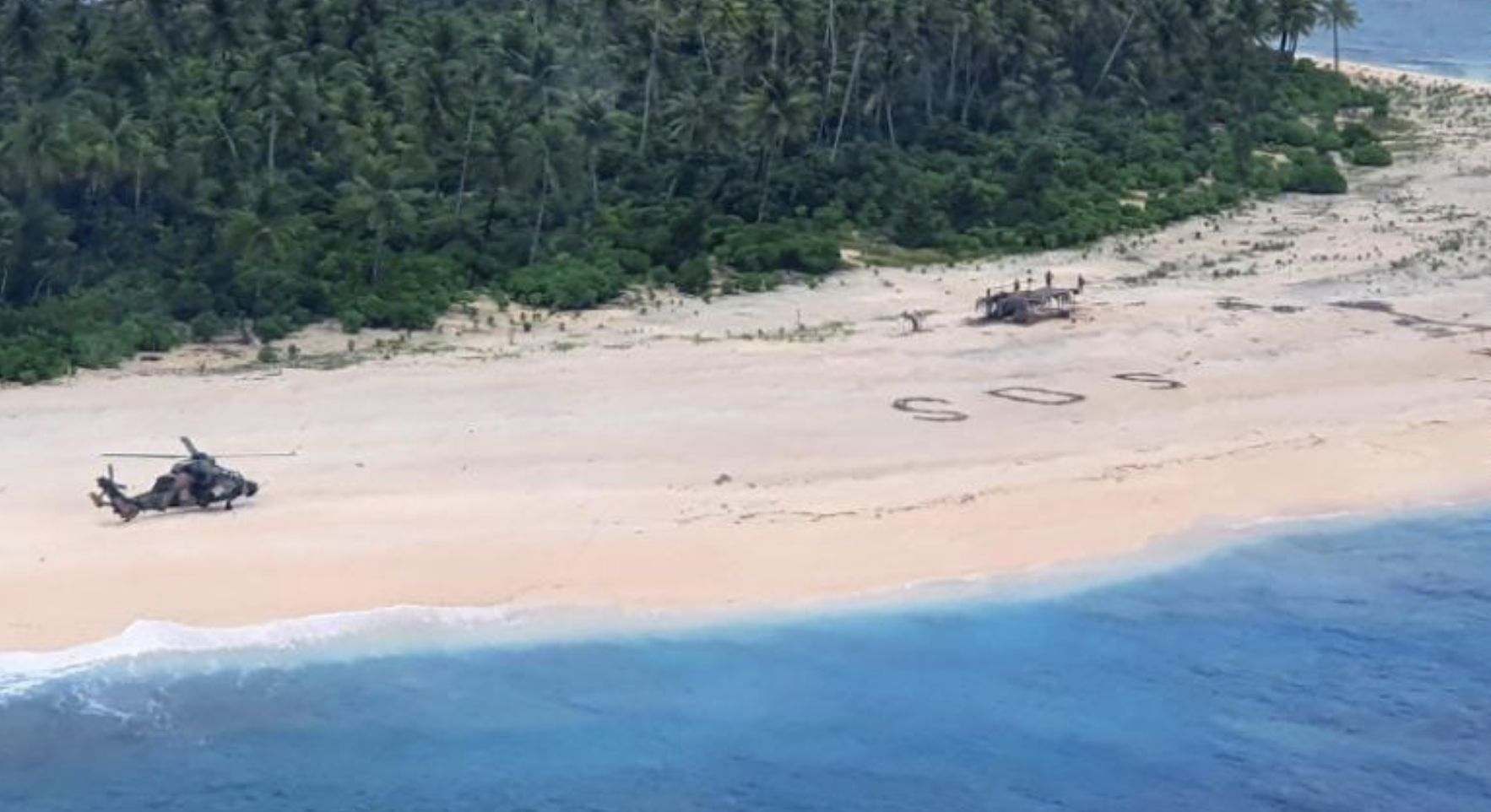 3 men saved after rescuers spotted a huge SOS in the sand on remote Pacific island   Thaiger