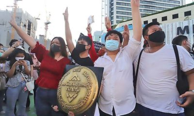 Protest leaders face charges for violating Thailand's lèse majesté law and for installing the plaque | The Thaiger